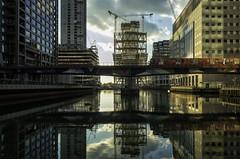 (DeepSane) Tags: london canarywharf dlr buildingsite reflections morganstanley sunset train