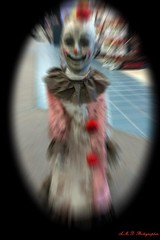 Someone let the clown out (PhotoJester40) Tags: indoors inside clown blurred smiling amdphotographer bloodspots horror halloweendecoration halloween