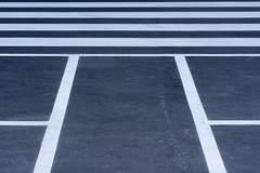 Parking and zebra (Jan van der Wolf) Tags: map17397v parking parkeerplaats parkinglot lines lijnen lijnenspel interplayoflines playoflines zebra blackandwhite zwartwit symmetric symmetrie symmetry abstract