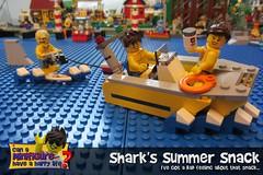 Shark's Summer Snack (EVWEB) Tags: lego shark jaws minifigure water sky boat ship sea beach guy girl happy humor fun lunch snack