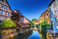 Ville de Colmar (Voyages Lambert) Tags: travel singleflower buildingexterior channel colmar facade timber littlevenice constructionframe halftimbered scenics medieval multicolored blue colors old frenchculture cultures small famousplace architecture traveldestinations urbanscene outdoors veniceitaly alsace france europe flower sunlight summer river water house restaurant canal street bridgemanmadestructure cityscape village town strasbourg sunny
