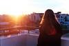 (intivisible) Tags: film 35mm analog analogic analógica prakticamtl3 fujisuperia400 woman mujer hair cabello back espalda sunset atardecer balcony balcón baranda city ciudad mirar contemplate contemplar flare