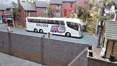 A Bulldog in Seaton Bay. (ManOfYorkshire) Tags: bulldog bus coach triaxle scania irizar p6 special livery 176 scale diecast model oogauge seatonbay diorama seaside bay water sea