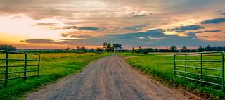 A farm; at sunset...