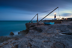 Portland Blue (burrills) Tags: dorset blue longexposure lighthouse dark water rocks crane boat portlandbill coast uk sea