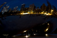 Cloud Gate (mariola aga) Tags: chicago millenniumpark cloudgate sculpture thebean downtown night evening skyscrapers city panorama reflection nightlights blue sky wideangle