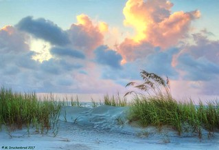 Dunes and Colorful early morning sky over the Atlantic Ocean