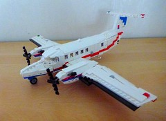 Air Ambulance - Fixed Wing (Lonnie.96) Tags: lego brick bricks moc own creation design custom 2017 september australia victoria ambulance plane fixed wing white red blue lines wings prop scale stud beechcraft king air super b200c emergency transport patient window cockpit landing gear cabin door functional vic service responce transfer stretcher minifig interior