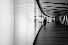 through (s@brina) Tags: undeground subway people reflections passage tubes light blackandwhite tunnel futuristic london