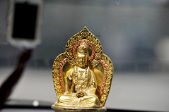 The true path? (Roving I) Tags: gold grab cabs buddhas beliefs religion taxis danang dashboards vietnam