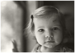 """A""  #41 2017; At the Window (hamsiksa) Tags: child children girl female infant toddler baby availablelight ambientlight window portrait candidportrait sepia blackwhite expression emotion"