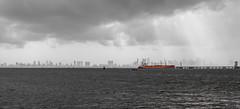 Mumbai Skyline and Orange Ship , View during  Monssons from the Elephanta island (Sebhue) Tags: mumbai monsones india elephantaisland bombay