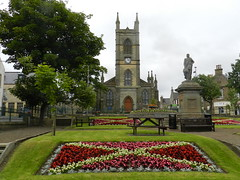 Sir John Square, Thurso, Caithness (allanmaciver) Tags: st peter andrew square john sinclair 1893 1879 flowers cross statue church style gardens central tree caithness north coast scotland colours grey day allanmaciver