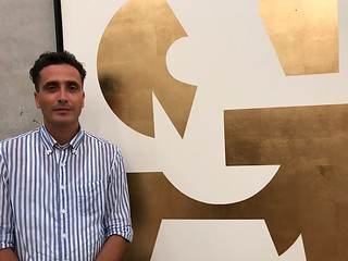 Artist Jose Angel Vincench Barrera with his artwork at the opening of contemporary Cuban art Chapter 2 at PAMM