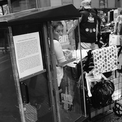 Flyer in Newspaper Stand About Police Impersonators and Peeping Toms (Zach K) Tags: handout flyer warning newspaper stand conspiracy newsie looking through window printed word streetphotography street photography photograph bw acros fujifilm x100f manhattan herald square new york city nyc broadway cart busy urban life