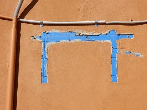Plaster on Blue Bricks