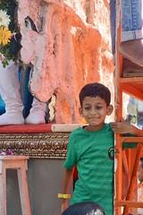 Child holding on to float at Ganesh Visarajan 2017, Mumbai. (Yekkes) Tags: asia india mumbai bombay people street urban city colour smile child happy fun