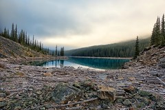 Moraine Lake Moraine (Philip Kuntz) Tags: lakemoraine fog sunrise sunup dawn daybreak rockpile moraine banff alberta