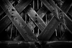 Strictly Prohibited! (trochford) Tags: conceptual prohibited forbidden barred blocked interdit metaphor wooden timbers beams bolts planks texture contrast hopkintonnh hopkintonnewhampshire nh newhampshire newengland usa canon ef24105mmf4lisusm bw bnw blackandwhite blackwhite noiretblanc blancoynegro mono monochrome