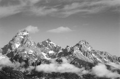 Cathedral Group (waarondaniel) Tags: jacksonhole jackson morning mountains peaks clouds mist analog kodak n90s nikon landscape mountainscape nature outdoor sky summer travel expore exploration film 35mm cathedralgroup grandtetons tetons mtowen teewinot blackandwhite tmax tmax100 telephoto