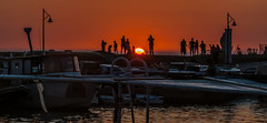 Crowd watching the sunset (Pejasar) Tags: byblos lebanon mediterraneansea water sun sunset people watching silhouettes evening dusk boats