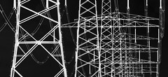 Dark Energy. (Hans Veuger) Tags: nederland thenetherlands oostzaan noordholland powerlines pylons thegrid nationalgrid polder hss nikon b700 coolpix nederlandvandaag twop unlimitedphotos inversion hoogspanningsmasten masten