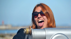 Down by the Telescope (Owen J Fitzpatrick) Tags: ojf people photography nikon fitzpatrick owen j joe pretty pavement chasing d3100 ireland editorial use only ojfitzpatrick eire dublin republic city tamron beautiful beauty attractive shades sunglasses prom promenade dunlaoire dun laoghaire girl candid natural candidphoto candidphotography red rua hair redhead mug mugging tongue telescope women portrait face visage street dslr digital streetphotography streetphoto irish