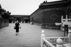 Encounter (Go-tea 郭天) Tags: pékin beijingshi chine cn beijing forbidden city imperial palace ancient construction building old wall candid tradition traditional tourist touristic history historical historic place venue portrait walk walking woman young alone lonely glasses bottle plastic mobile phone cell cellphone cellular bag doors gate closed empty tree street urban outside outdoor people bw bnw black white blackwhite blackandwhite monochrome naturallight natural light asia asian china chinese canon eos 100d 24mm prime lady