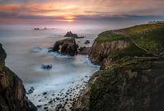 Fading Light, Land's End (Mick Blakey) Tags: coastsurf goldenhour sunset cornish cliffs rocky landsend orange sea rocks coastpath coastal granite goldenlight waves silhoette lighthouse golden shoreline coast seascape red cornwall dusk clouds