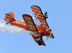 Wing Walkers (Bernie Condon) Tags: breitling wingwalkers girls ladies aerobatics wingwalking aerosuperbatics boeing stearman trainer vintage classic preserved aircraft plane biplane bigginhill airport londonbigginhill historic airfield airshow aviation display flying planes festivalofflight