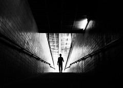 outsider (/ urban.fishing /) Tags: silhouette stairs human dark shadow light glow contrast urban city underground