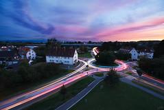 Roundabout (johaennesy) Tags: friedrichshafen traffic lighttrails streets starstax opensourcesoftware hugin gimp bluehour cityscape