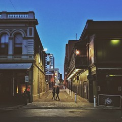 Everyday #Adelaide 430 (Dawn on Hindley Street) (michelle-robinson.com) Tags: smartphone snapseed everydayadelaide adelaidephotographer southaustralia 4tografie adelaide iphone7plus australia vsco photography everyday streetphotography editedonipadpro documentary citylife everydayaustralia photographer michellerobinson observations urban flickrelite shotoniphone procamera iphoneography couple colourphotography diminishingperspective walking peaceful everybodystreet morning life dailylife exterior buildings hindleystreet quiet laneway architecture silhouettes streetlife lowlights street