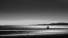 Sandymount beach - Dublin, Ireland - Black and white street photography (Giuseppe Milo (www.pixael.com)) Tags: streetphotography ireland street city faceless clouds light urban man contrast sea candid black photo photography dublin blackandwhite sky europe bw white countydublin ie onsale