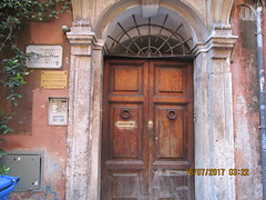 The Tired Entrance (RubyGoes) Tags: lazio trastevere rome italy door dottore ciaravino brown grey blue green leaves wooden