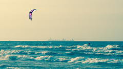 chi fly guy (Clickumentary) Tags: lake michigan kite surfer kitesurfing waves wind skyline chicago millerbeach