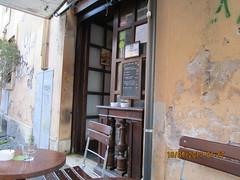 Decadence (RubyGoes) Tags: trastevere rome italy graffiti chair yable glass ashtray blackboard menu restaurant oleander plant