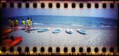 beachlife II (Ulla M.) Tags: beach beachlife sprocketrocket selfdeveloped selbstentwickelt sprocketholes umphotoart panoramaformat analog canoscan8800f lomo freihand analogue film kleinbild 35mm mittelmeer mediterraneansea ishootfilm