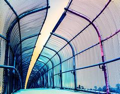 freeway pedestrian fenced bridge (fe2cruz) Tags: california ca flash filters film 35mm bridge fence chainlink freeway anaheim analog socal southerncalifornia orangecounty fences crazytuesdaytheme 7dwf curves