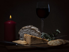 In the Candlelight (Marinda_95) Tags: inthecandlelight candle flickr flickrfriday flash highlights light fire flame soft lighting bread cheese olive crackers knife board wine red