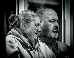 STUDY IN CONTASTS: THE RIDE HOME (panache2620) Tags: couple spouses marriage manandwife urban city minneapolis minnesota publictransportation lightrail monochrome bw vignette contrasts fineart eos candid documentary