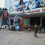 Vietnam War - Hue, 17 Feb 1968 - US Marines Approaching Movie Theater Displays - Photo by Nik Wheeler thumbnail