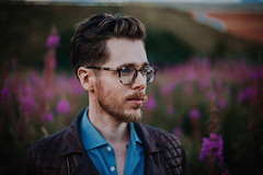 Iolla (Mark Liddell) Tags: glasgow scotland me self portrait nerd geek glasses specs spectacles iolla bell frames tortoiseshell plastic scottish man boy guy hair quiff hairstyle blue eyes lips profile ear piercing cartilage industrial shirt stubble beard outdoors heather purple flowers bokeh markliddell nature plants field sunset fashion style allsaints leather conroy jacket coat gay