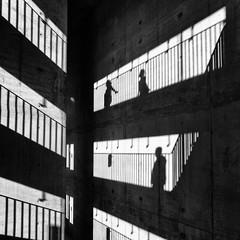 Shadow Play (laga2001) Tags: shadow light play building sun people black white monochrome sunlight concrete wall