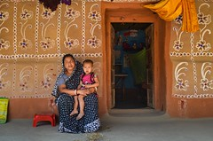 Santals tribe traditional painted house (ashik mahmud 1847) Tags: bangladesh d5100 nikkor people mother child kids painting design colorful home house travel travelphotography santalspaintedhouse