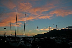 BlackDot (lauttone1) Tags: sunset clouds nuvole black dot punto nero pecora nera salerno campania italia italy canon eos 400d street streetphotography alberi boats barche vela red