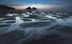 Beachscape, Holywell Bay (Mick Blakey) Tags: shoreline sand sunset mickblakey cliffs holywellbay cornish cscapeart orange clouds dusk shadows blue tide cornwall beach silhoette dreamy twilight sun sea seascape coastal coast contrast surreal