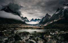 Darklands (One_Penny) Tags: adventure arctic canon6d greenland hiking landscape mountains nature northpole outdoor photography phototour travel dark sinister rocks stones rugged clouds peaks lake water terrain moody tones sky mountainscape scenery