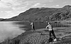 Go on son (plot19) Tags: crummock water lake district britain british blackwhite fishing fly nikon north northern northwest plot19 photography people england english landscape