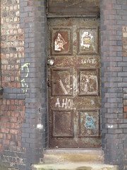 A locked doorway to love - Graffiti on a rusted steel door to an abandoned building (rylojr1977) Tags: door rusted dilapidated rundown locked love graffiti tagged liverpool abandoned bricks steps